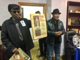 STILL FIGHTING: Billy Brooks and Emory Douglas, two former Black Panther Party members, show off an old copy of the party's newspaper during a Black Panther Party health fair on Nov. 3. | BONNIE McKEOWN/Contributor