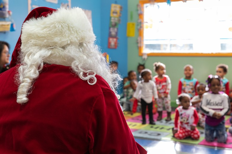 TIS THE SEASON ... TO SEE SANTA: Sheriff's deputies mingle with children during a visit from Santa on Dec. 19. | Submitted photos