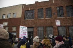Demonstrators rally outside on Saturday, Jan. 12, during a Mute R. Kelly protest outside of his studio on Justine Street in Chicago. | ALEXA ROGALS/Staff Photographer