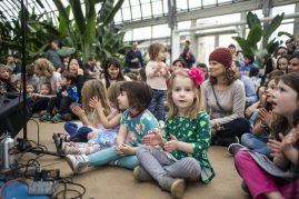 Captivated: Kids sit on the ground and listen to live music from the Little Miss Ann Band. | ALEXA ROGALS/Staff Photographer