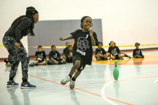 A team member from the Warriors races around the court during an event on Saturday, March 9, during the Community Works and Sports Alternative Youth Olympics event at the By The Hand Club For Kids in Austin.   ALEXA ROGALS/Staff Photographer
