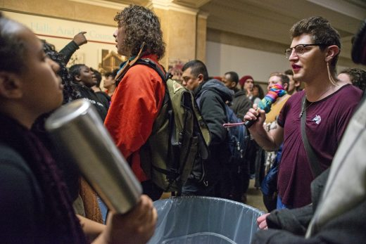 Protesters chant in the hall on Wednesday, March 13, during the protest outside of council chambers on the second floor of Chicago City Hall on LaSalle Street. | ALEXA ROGALS/Staff Photographer