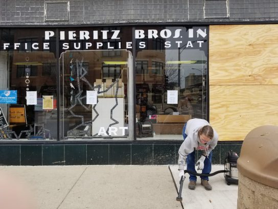 Debris from the crash smashed windows at Pieritz Brothers Inc., whose employees were still cleaning up the area two days later. | TIMOTHY INKLEBARGER/Staff