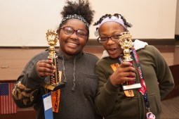 Great American spellers: Jimerreiah Nash, 10, and Janiyah Johnson, 9, hold up their trophies after the Great American Spelling Bee on April 19, at the Austin Branch Library. | SHANEL ROMAIN/Contributor