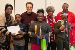 ALL WINNERS: Spelling Bee participants pose with Austin Branch Library officials, bee organizers and other adults. Front row, left to right: Sema'j B. Myles, Jimerreiah Nash and Janiyah Johnson. | SHANEL ROMAIN/Contributor