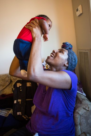 "Amber Gates, 28, at home with her son. Gates always knew she wanted to give birth outside of a hospital setting. On her relationship with the midwives at the birth center where she gave birth, Gates said, ""They just kind of made me not feel fear. Like yeah, I could do this...So I got somebody who physically was there, I got one person that's just encouraging me emotionally...and these three women was able to give me a piece of mind when I was birthing my son."""