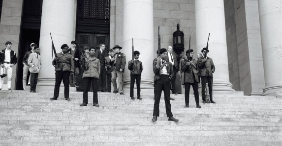 REVOLUTIONARIES, TOO: Black Panthers on the capitol steps in Olympia, Wa. in 1969. They were protesting gun legislation. | Washington State Archives