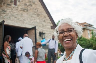 MOVING IN: Annie Beckworth, a member of Rose of Sharon Community Church since 1960, said she's satisfied with the congregation's new location inside of one of Maywood's most historic church buildings. Below left, Rev. Austin and other congregants outside of the new church before service on July 7. | SHANEL ROMAIN/Contributor