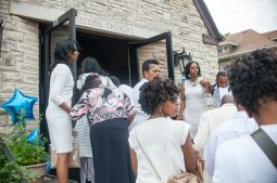 Congregants outside of the new church before service on July 7. | SHANEL ROMAIN/Contributor
