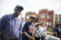 Congressmen Danny Davis, middle, walks with a group in the parade during the 40th annual Danny Davis Back to School Parade along Central Avenue in Austin. | ALEXA ROGALS/Staff Photographer