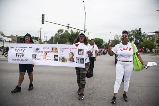 """A group of members from the Families of Fallen Children chant """"put the guns down"""" on Saturday, Aug. 17, during the 40th annual Danny Davis Back to School Parade along Central Avenue in Chicago's Austin neighborhood. 