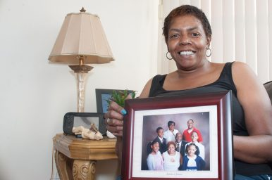 STEPPING IN: Patricia Rencher, of Austin, with a photo of her family. Rencher and her husband Ronnie are raising their four grandchildren. The couple was inducted into Senate Majority Leader Kimberly Lightford's Grandparents Raising Grandchildren Hall of Fame in 2018.   SHANEL ROMAIN/Contributor