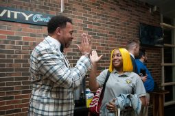Truman College President Shawn Jackson greets Michele Clark High School senior Dejah Tague on Sept. 3, the first day of school for CPS students. Jackson was among a coterie of community leaders, including Congressman Danny K. Davis and state Rep. La Shawn K. Ford, who welcomed Michele Clark students their first day back. | SHANEL ROMAIN/Contributor