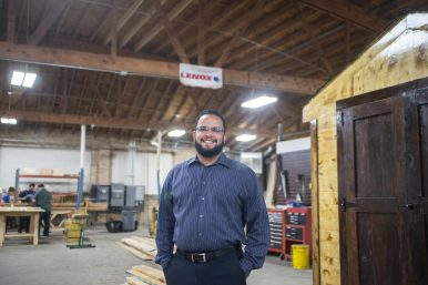 LEADING THE WAY: Manny Rodriguez inside of his woodworking shop in West Garfield Park. Rodriguez trains people in carpentry and construction, which can lead to job opportunities. | ALEX ROGALS/Staff Photographer