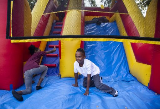 Kids play in one of the inflatable gyms outside on Sept. 13, during the Lights in the Night event at Columbus Park in Austin. | ALEX ROGALS/Staff Photographer