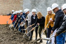 EXPANDING OUT: Donnita Travis, third from right, the founder and executive director of By The Hand during the Oct. 5 groundbreaking ceremony for the nonprofit's new building. | Courtesy Novak Contstruction