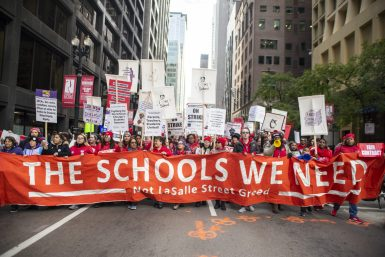 TAKING TO THE STREETS: Chicago Teachers Union and SEIU workers march downtown on Oct. 17, the first day of the strike. | ALEX ROGALS/Staff Photographer
