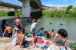 'ABYSMAL': Families wash up and swim in the Rio Grande, near the U.S.-Mexico border. Local faith leaders and activists who took a trip to the border last week are now calling for Congress to end Migrant Protection Protocols, or MPP, a measure implemented by U.S. Customs and Border Patrols that has resulted in a backlog of immigration cases and overcrowded, unsanitary tent cities. | Photo by Paul Goyette