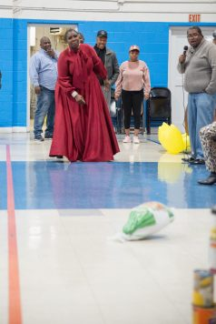A bountiful day: Truniekia Franklin participates in a game of turkey bowling during the 12th Annual Soul Food Powwow. | SHANEL ROMAIN/Contributor
