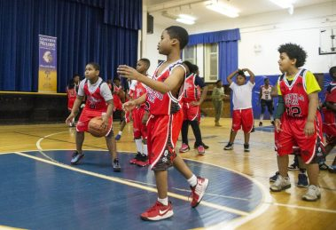 A group of kids from the Garfield Park league watch a scrimmage. | ALEX ROGALS/Staff Photographer