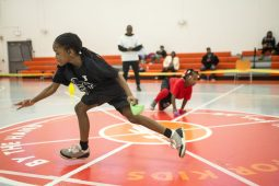 Players race to the middle of the gym to grab bean bags for their team on March 9, during the Community Works and Sports Alternative Youth Olympics at By the Hand Club for Kids. | Photo by ALEX ROGALS/Staff Photographer