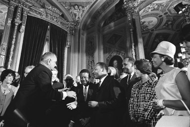 THE RADICAL KING: Above, King meets with President Lyndon B. Johnson. at the signing of the Voting Rights Act of 1965. | Photo courtesy Creative Commons