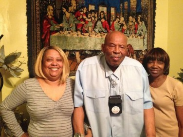 "AN ANCHOR: Rev. Crawford, center, with his wife Patti, left, and F.A.I.T.H. Inc. case manager Parmelia ""DeDe"" Tyler, pictured in the Crawfords' Austin home in 2016. 