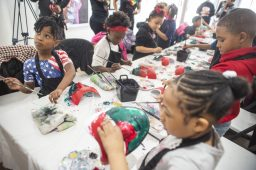 YOUNG, GIFTED, BLACK: Students paint during a Feb. 28 Paint & Punch event held at 345 Art Gallery in East Garfield Park. The gallery wants to give the city's young people dynamic lessons in art and culture. | ALEX ROGALS/Staff Photographer