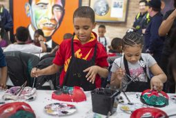 INSPIRED: Children use different colors to paint their own masks on Feb. 28, during a Paint and Punch event at the 345 Gallery in East Garfield Park.