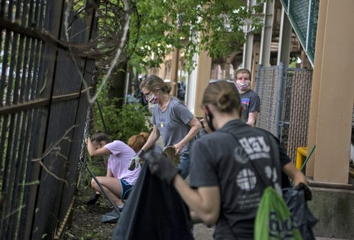 Volunteers clean up a vacant lot in Austin on June 3, days after looting and vandalism swept the West Side and other areas of the Chicago metropolitan area in the wake of the May 25 death of George Floyd. | Alex Rogals/Staff