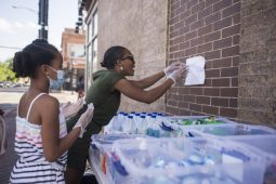 Each week, London Black, an Austin native, organizes a personal care and toiletry products giveaway outside of Taco Bros restaurant on the corner of Chicago Avenue and Austin Boulevard. | Alex Rogals/Staff Photographer
