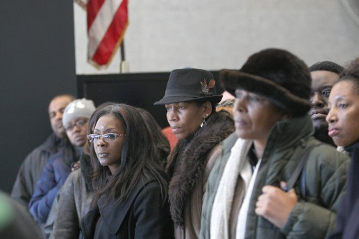 On his side: More than 50 supporters went to federal court in downtown Chicago to support LaShawn Ford during his arraignment. Here, they listen to comments his attorney is making to the press.