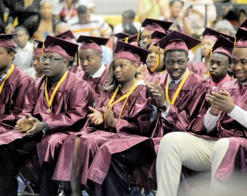 Students clap for Mayor Rahm Emanuel's speech during Christ the King's inaugural senior graduation in June at the school, 5088 W. Jackson.