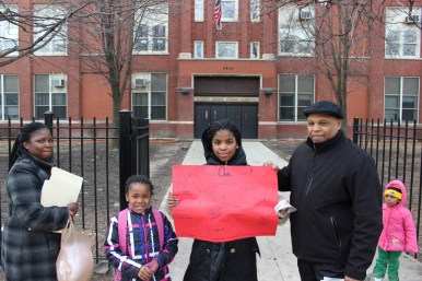 Community activist Dwayne Truss joined other Austin families outside May School, 512 S. Lavergne, on March 22 to protest CPS' decision to close May and other west side schools in June.File photo