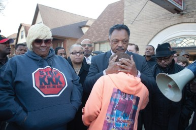 The Rev. Jesse Jackson hugs Donna Hall, whose son, Marshall, was killed by gun violence, during a peace rally and march in Austin. The rally began at Greater St. John Bible Church and participants walked to the site of the murder of Heaven Sutton, 7. Next to Jackson is Ashake Banks, left, Heaven's mother.DAVID PIERINI/Staff Photographer
