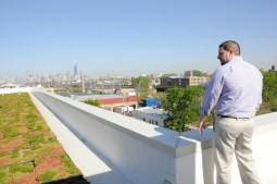 The future: Brandon Crow, an administrator at Garfield Park's Hope Manor, a housing facility for homeless vets, looks out over the manor's green rooftop toward the Chicago skyline. The two-year old manor has plans to expand beyond the West Side.Photos by ESTHER BERGDAHL/Contributor