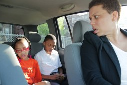 Nikkitta McCoy, a single mother of four, drives her three younger children, Nikeal (from left, hidden by the headrest), Nariah and Nolan, to St. Malachy School on Chicago's West Side.