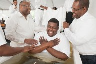Richard Hayes was all smiles before elders dipped his head under the water to baptize him.