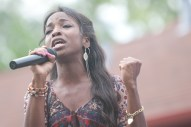 """Jasmine Barnes sings """"Greater Is Coming"""" to the crowd at Moore Park who turned out for National Night Out festivities. (David Pierini/staff photographer)"""