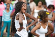 Kayla Olatunji dances with her group, Aggression, during National Night Out festivities in Moore Park. (David Pierini/staff photographer)