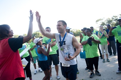 Overall male winner Jacques-Rene Hebert gets a high five after his name was called.
