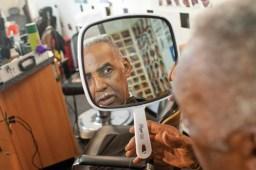 The Rev. J.W. Clay Brooks looks at his finished cut. (David Pierini/staff photographer)