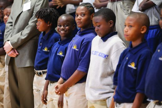 Chicago Jesuit Academy fifth-graders wait for the building dedication ceremony in their renovated gym. (Photo by Diane M. Smutny/DMS Photography)