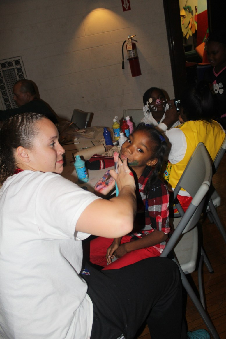 Brianna Concepcion paints Catia Hopson's face at Austin Town Hall Oct. 29, for the hall's annual Halloween event. See page 6 for photos of the Haunted House at Austin Town Hall. (Photos by Daisey Winfrey/Contributor)