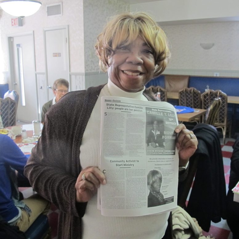 Connie McLendon holds up the article about her in the Women in Business section of Austin Weekly News.