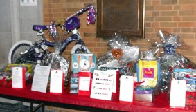 Just one of the three tables full of raffle prizes
