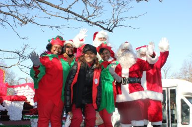 Rep. Camille Y. Lilly (78th District) and vice president of external affairs at Loretto Hospital with Elf and Santa Volunteers