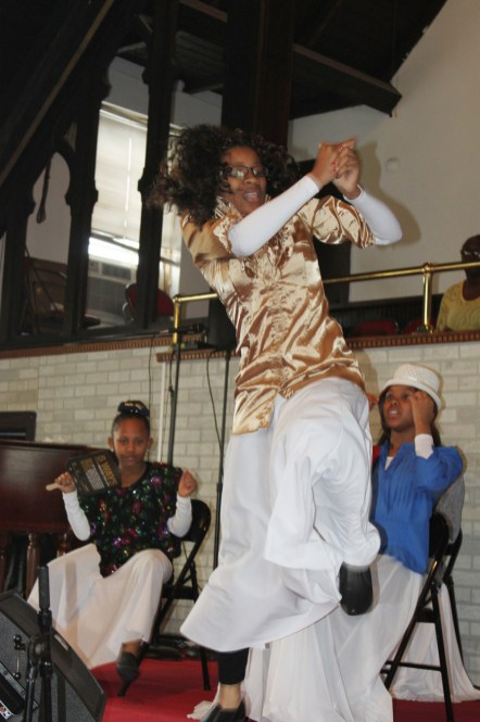 At Greater St. John Bible Church in Austin, youth perform a praise dance at a April 14, Sunday service; (DAISY WINFREY/Contributor)