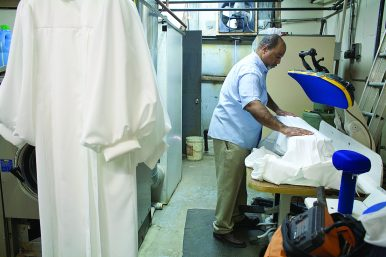 Come clean: James Forrest presses choir robes at Forrest Cleaners, a business on West Chicago Avenue, started by his father in 1963. It was the first black owned dry cleaners on the city's West Side.(DAVID PIERINI/Staff Photographer)