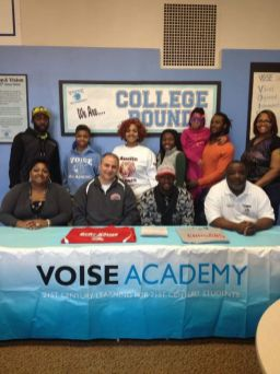 Christopher Thompson, sitting front row and third from the left, at the March 10 signing ceremony at VOISE Academy. (Photo courtesy of Kim Thompson)